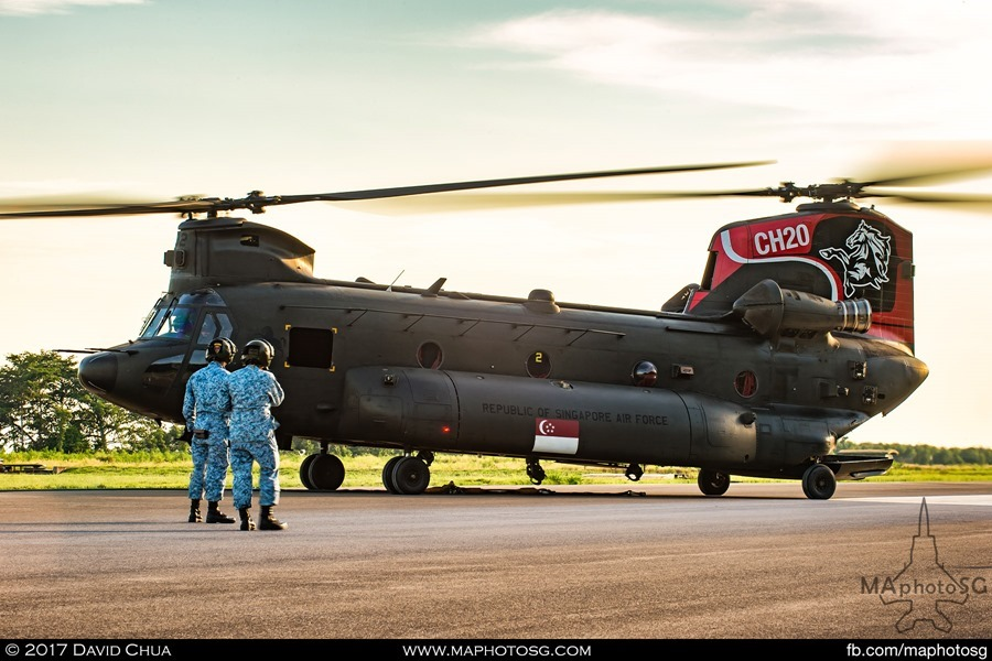 NDP State Flag flypast: RSAF Ground crew watches as the CH-47D Chinook moves into position for hook up