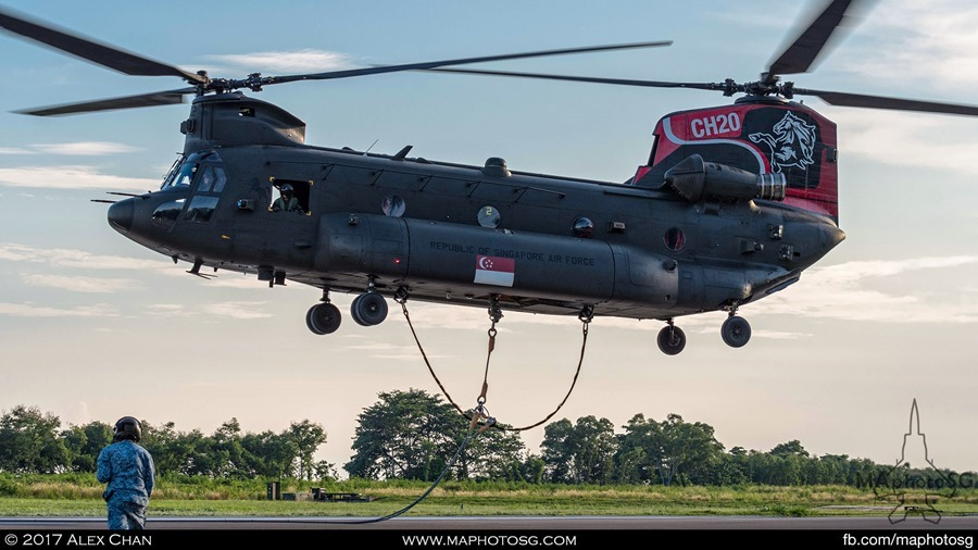 CH-47D Chinook lifts off once the 3 hooks are attached