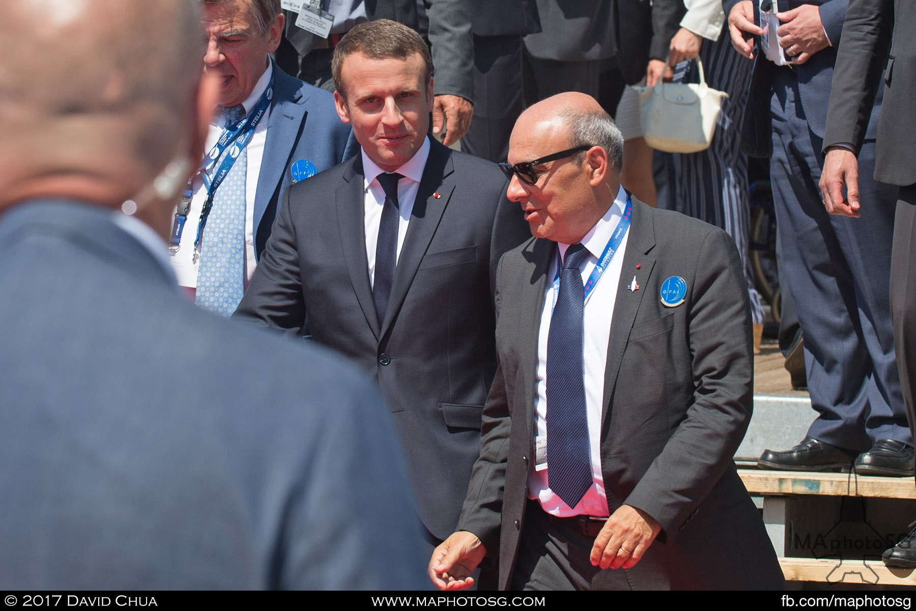 6. French President Emmanuel Macron walks with Dassault Aviation CEO Eric Trappier after watching the demonstration flights at the GIFAS Chalet. Macron landed at Le  Bourget in an Airbus A400M military transport plane to launch the Paris Air Show.