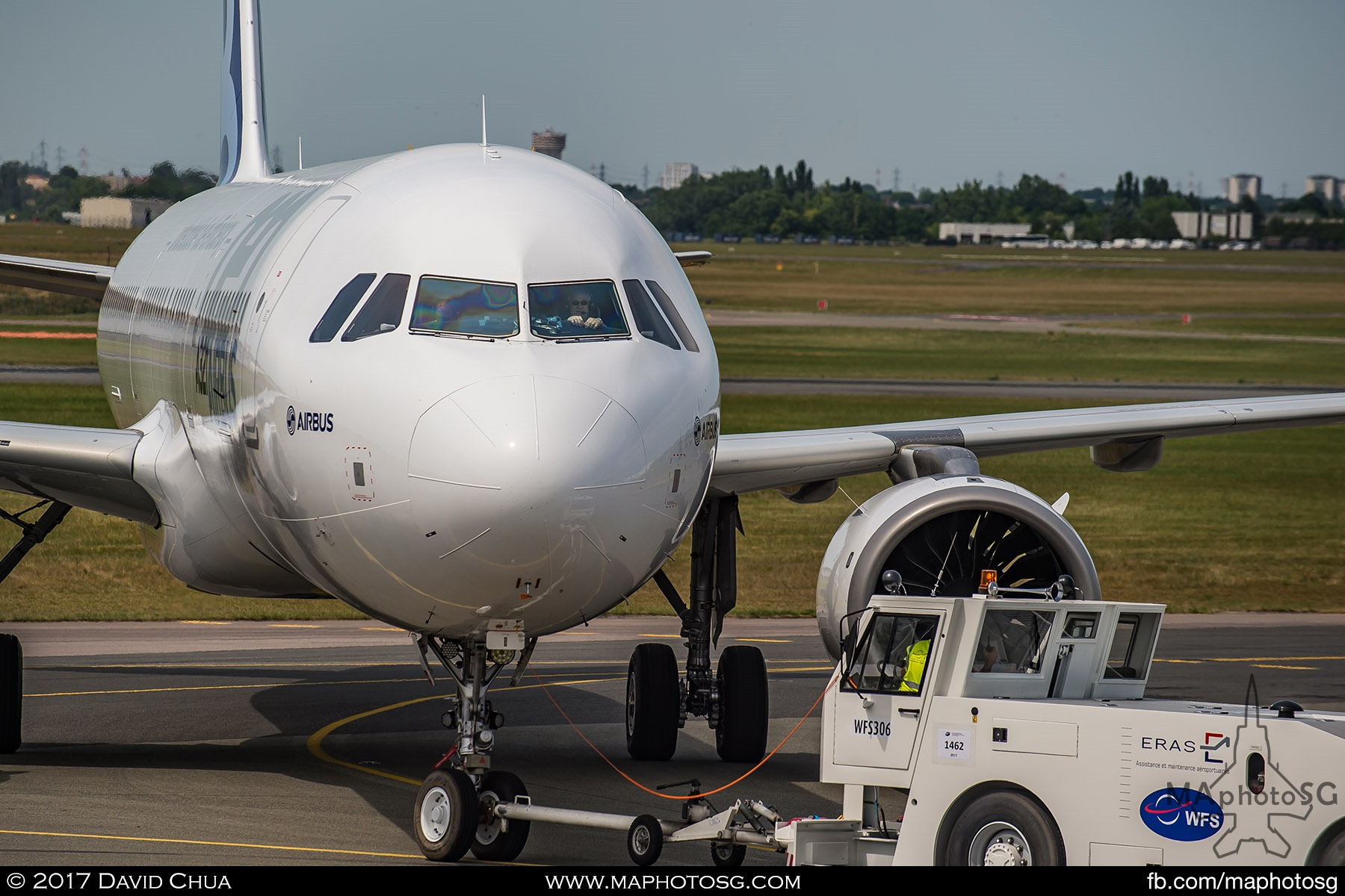 35. Pilot of the Airbus A320neo looks on as the aircraft is towed back to the Static Display Area.