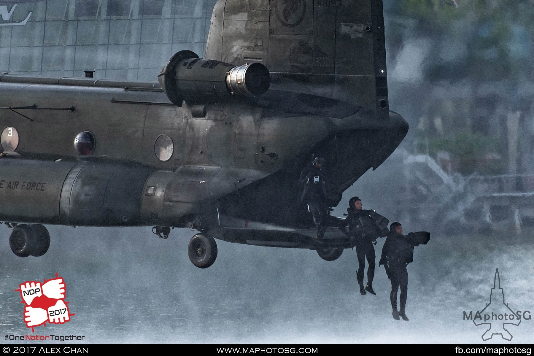 12. Navy Divers inserting into the water from the CH-47D Chinook's ramp.