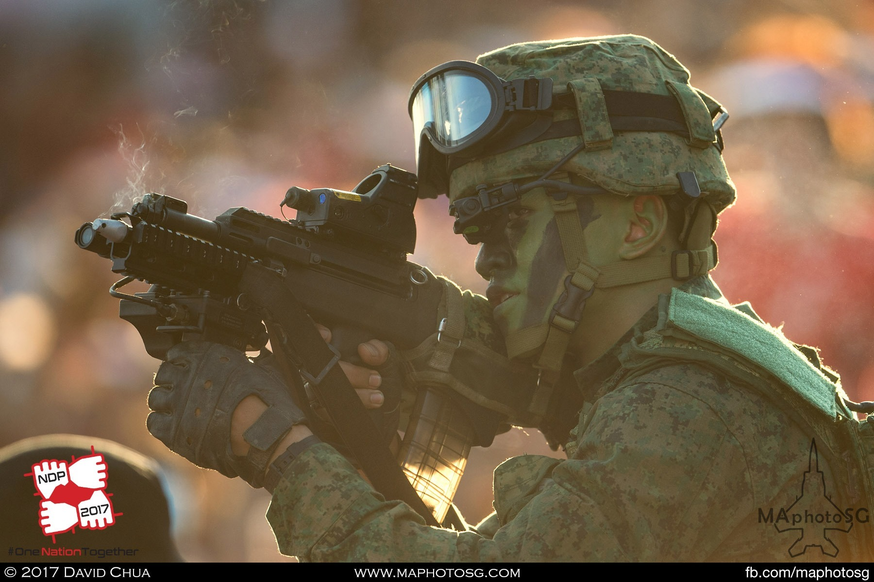 16. Infantryman from the Singapore Armed Forces in action within the spectator stands.