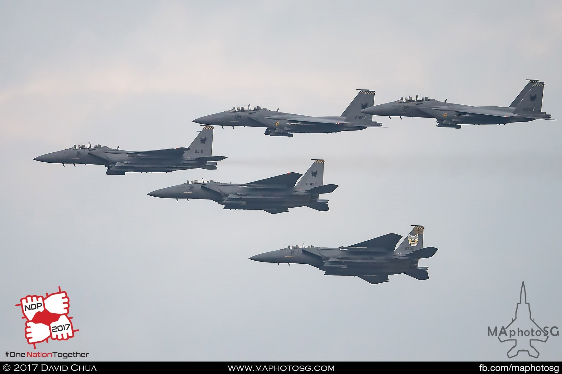 21. Five F-15SG Strike Eagles from 149 Squadron flies in formation to perform the Salute to the Nation bomb burst.