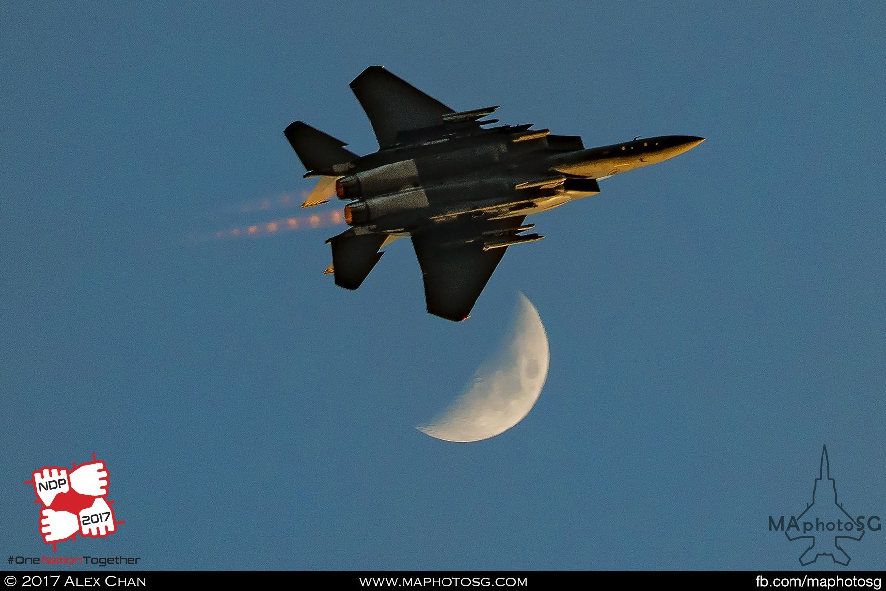 23. A single F-15SG passes the moon after the Salute to the Nation.