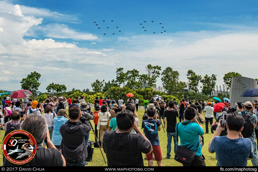 "Crowd gathered at Marina Barrage as the ""50"" Formation flies overhead"
