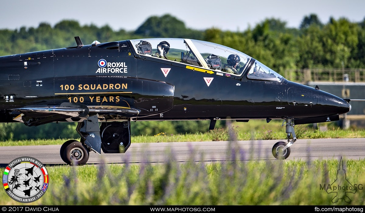 5. Crew of the Royal Air Force Hawk T1 (XX285) in 100 Years livery waves as it taxis past. Aircraft is from the RAF No 100 Squadron also celebrating it's centenary.