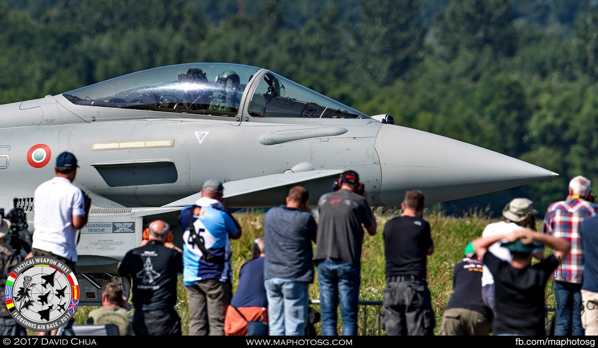 29. Pilot of the Italian Air Force Eurofighter Typhoon from 4° Stormo waves to the line of photographers as he taxis pass.