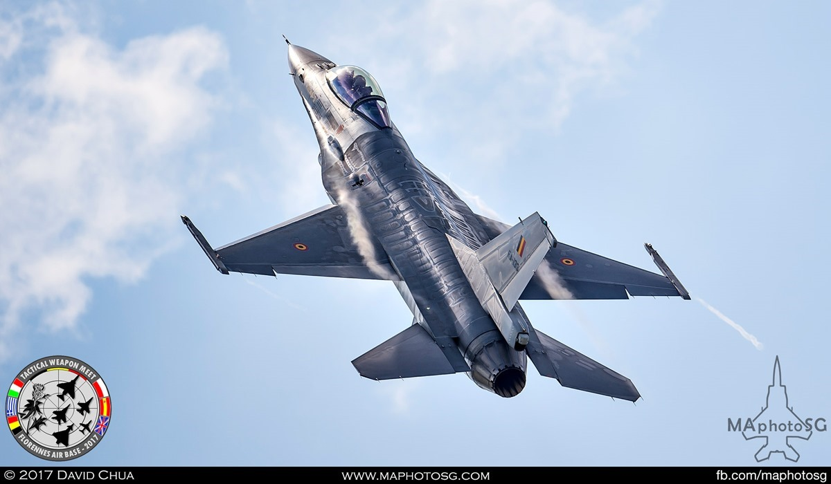 35. Belgian Air Force F-16A MLU (FA-133) glints of the sun as it pulls up after a low pass.