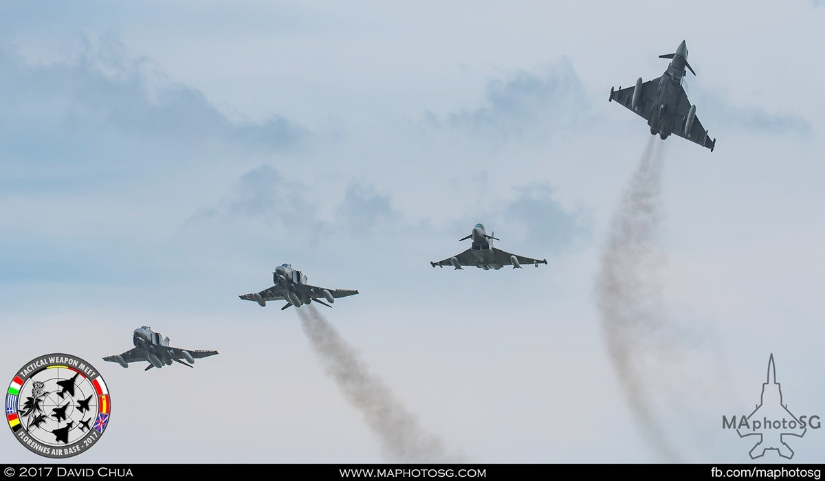 42. 4 ship formation of 2 Eurofighter Typhoons and 2 F-4E Phantom IIs breaks as it flies pass the airfield.