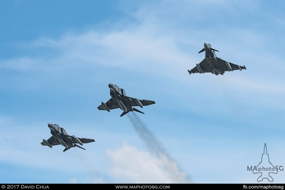 The old and the new, a formation of Phantoms and Eurofighter flies overhead as they return to base during Tactical Weapon Meet 2017