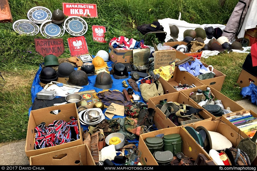 """Lots of personal equipment and also Mercedes Benz wheel hubs and a """"Danger Mine"""" sign"""