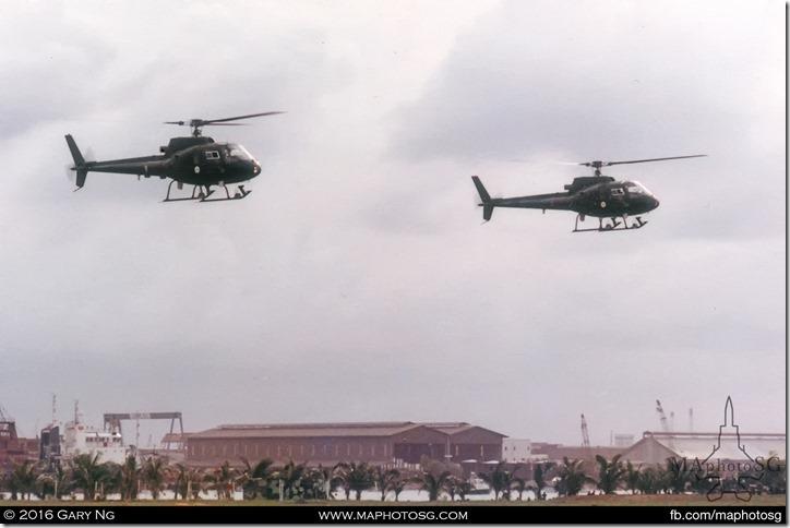 Eurocopter AS350B Écureuils of 123 Squadron performing heli-aerobatics, SAF Display, West Coast Park, July 1983