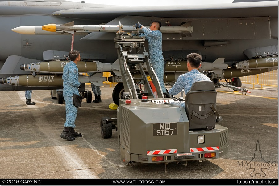 AFEs load an AIM-9X on an F-15SG as part of the Arming Demonstration preview