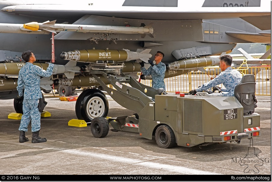 AFEs load a Mk.82 bomb on an F-15SG as part of the Arming Demonstration preview