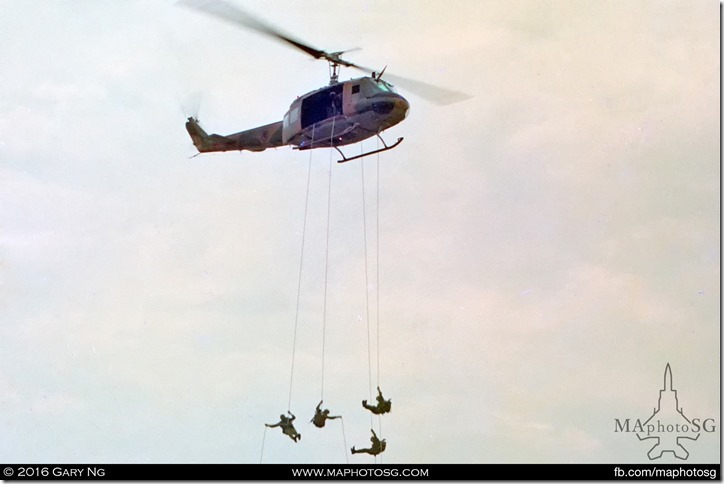 A Bell UH-1H Iroquois in a rapelling display, RSAF 25th Anniversary, Paya Lebar Airbase, September 1993
