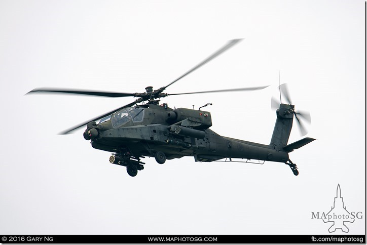 One of the pair of AH-64D Longbow Apache providing cover for the Chinook insertion