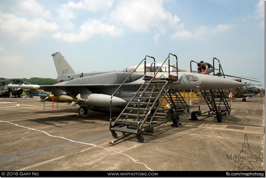 F-16D crew prepare the aircraft during setup for the RSAF Open House 2016
