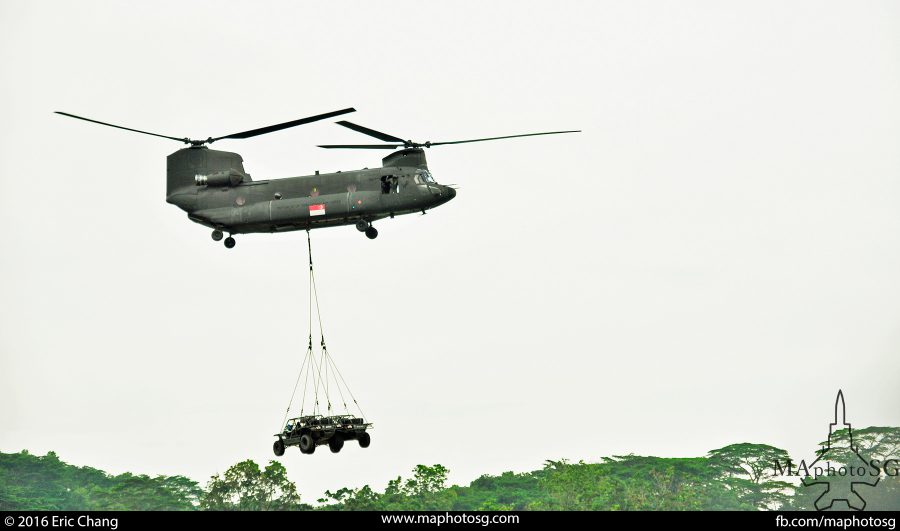 RSAF's CH-47SD Chinook heavylift helicopter transporting Army Light Strike Vehicles