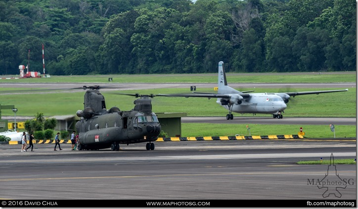 Joyride participants boarding a CH-47D Chinook while a Fokker 50 taxies for take off.