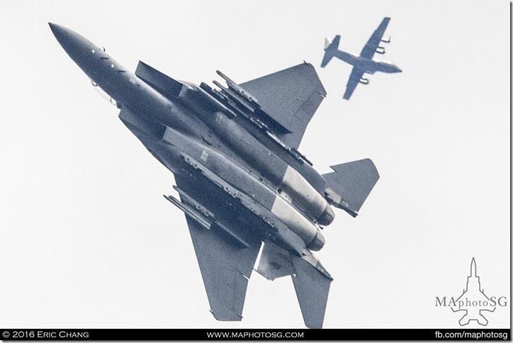 F-15SG passes a C-130