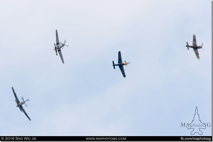 North American P-51D Mustang, North American TF-51D Mustang and two Hispano Buchón (Messerschmitt Bf 109) in simulated dogfight.