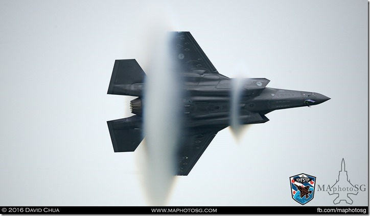 Condensation cones as the F-35A does a high G maneuver in very dense atmospheric conditions