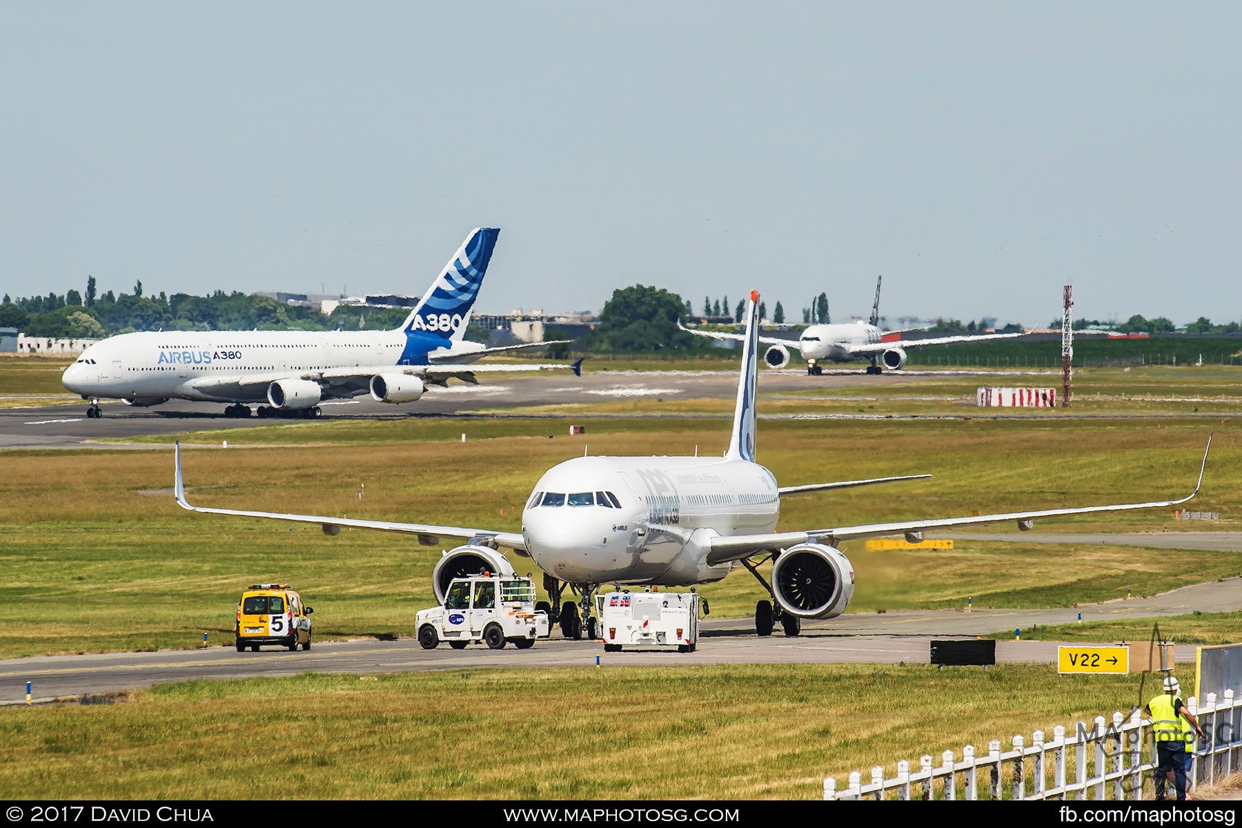 34. A trio of Airbuses on the tarmac at the same time. The A320neo in the centre taxiing back after it's demonstration flight while an A380-800 crosses the runway to prepare for it's display while the A350-1000 is at the end of the runway ready for take off once the A380-800 clears.
