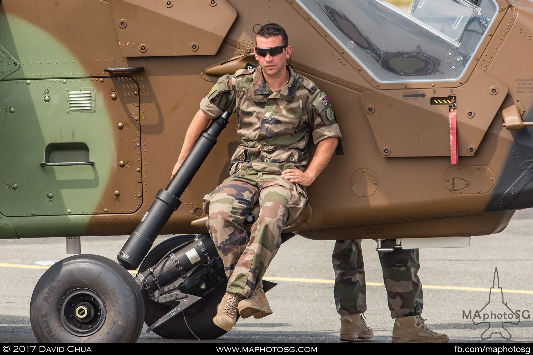 37. Crew of the Airbus Helicopter Tiger relaxes as the aircraft is towed out for it's aerial display.