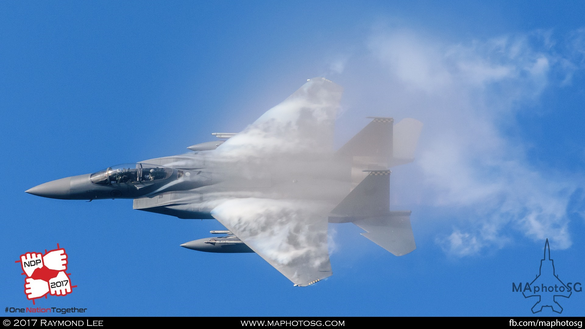 6. Massive vapour trails form on the wings of a F-15SG as it performs a 360 degree high-g turn.