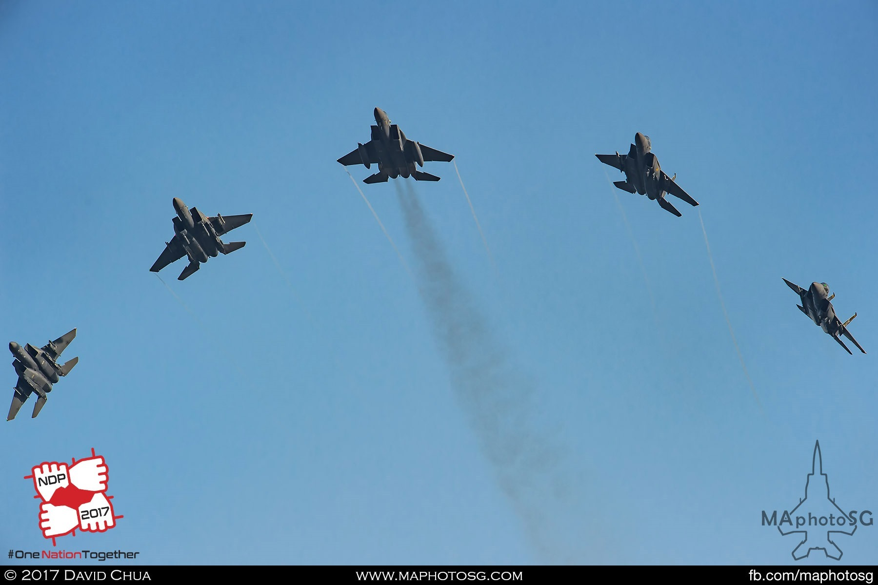 22. Five F-15SG Strike Eagles from 149 Squadron breaks as they performs the bomb burst maneuver.