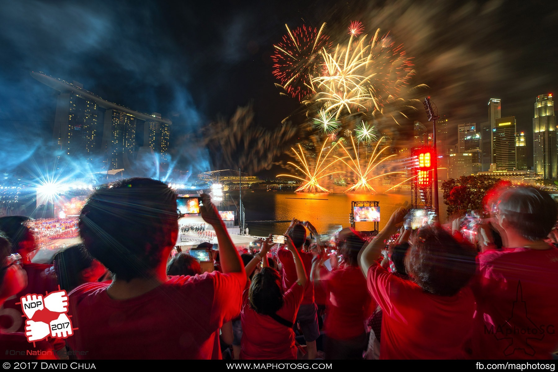 40. Grand Finale as spectators sing to a medley of NDP songs while fireworks goes off in the Marina Bay.