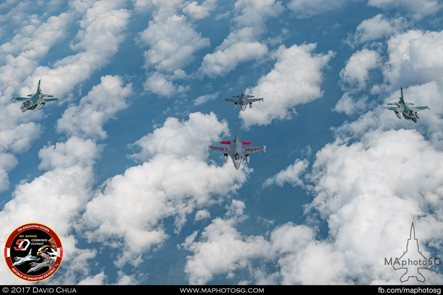 Two RSAF F-16s(front and back) and two TNI-AU F-16s(left and right) conducting work-up training for the combined flypast within Singapore and Indonesia airspace