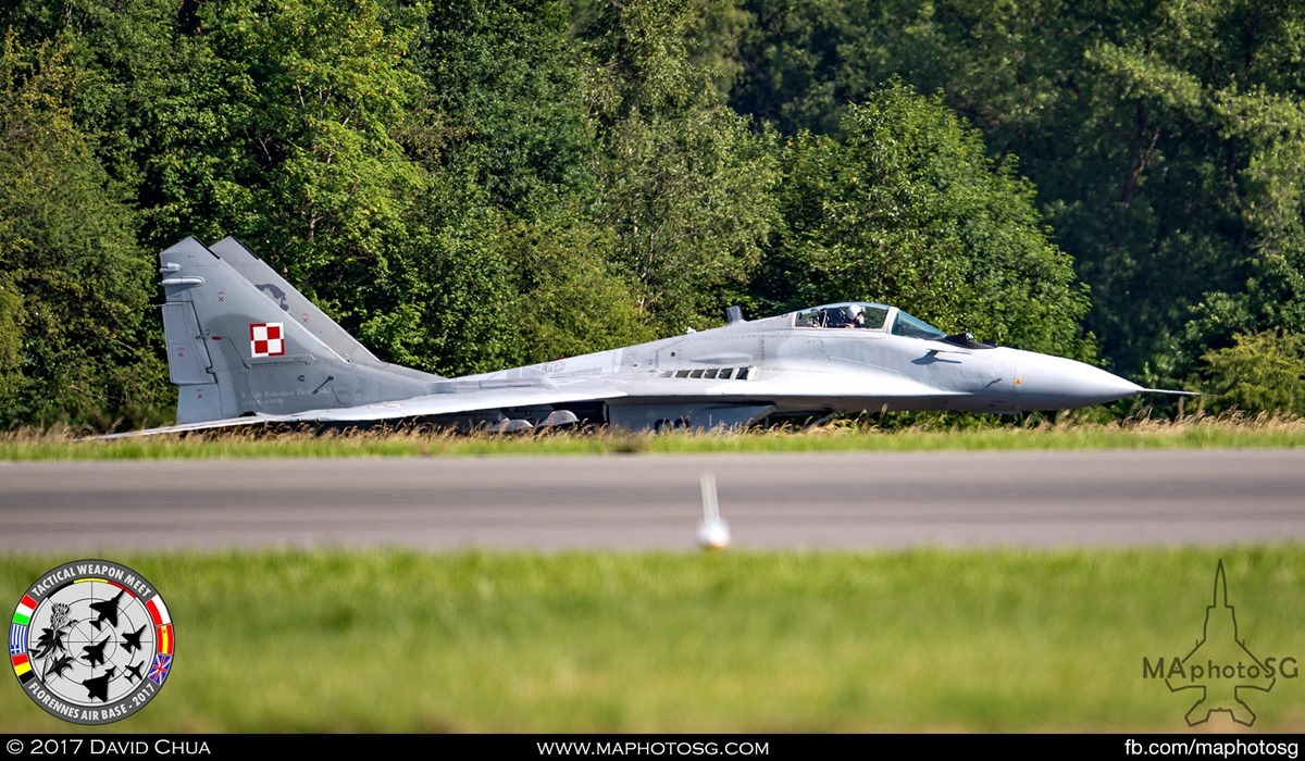 8. Polish Air Force MIG-29 Fulcrum (89) from its 1st Tactical Squadron taxis below the runway to take off.