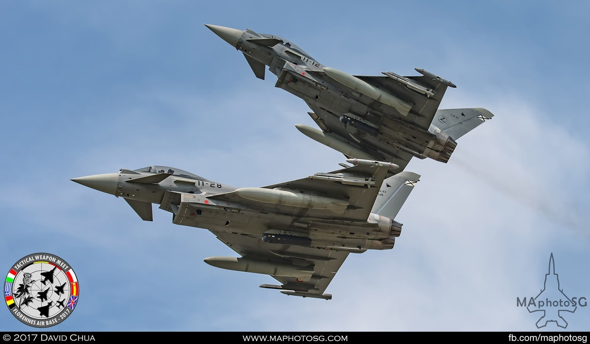 33. A pair of Spanish Air Force Eurofighter Typhoons (11-28 and 11-12) from Ala 11 breaks formation as it over flies the airfield.