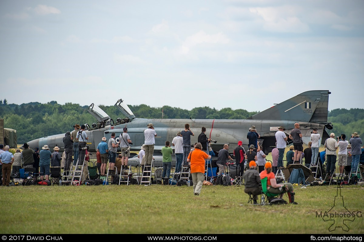 The crowd gathers as one of the Phantoms taxis past after landing