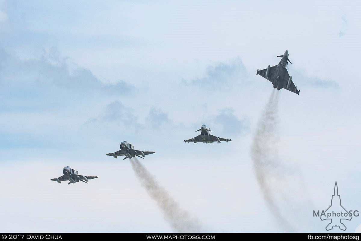 The old and the new, a formation of 2 Phantoms and 2 Eurofighters flies overhead as one of the Eurofighters breaks