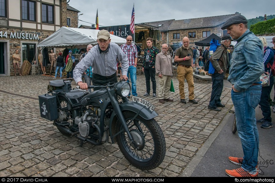 Visitors watch as the owner of this vintage BMW R71 starts it up