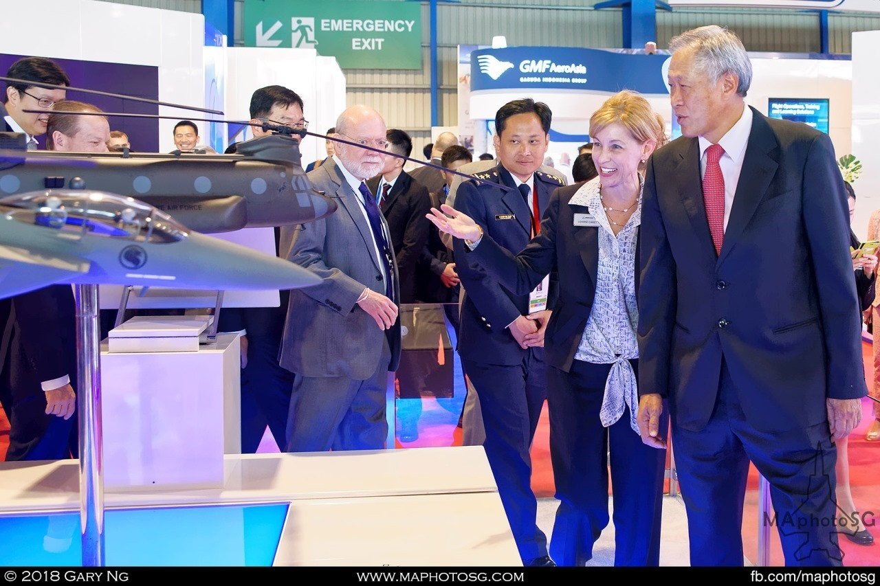 Leanne Caret of Boeing hosts Defence Minister Ng Eng Hen and Chief of Air Force Mervyn Tan at the Boeing booth
