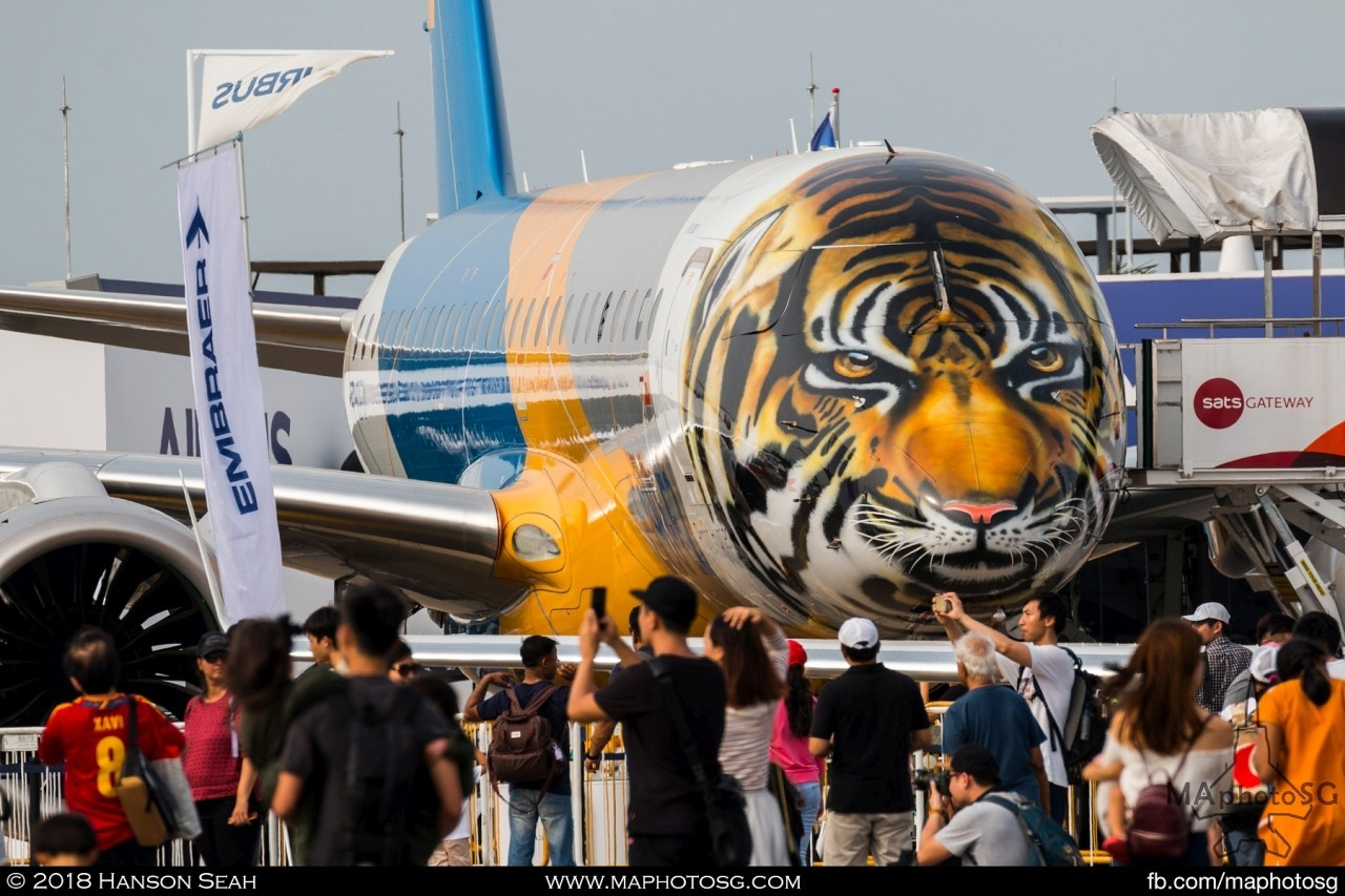 "Embraer E190-E2 ""Profit Hunter"" with special tiger livery on static display"
