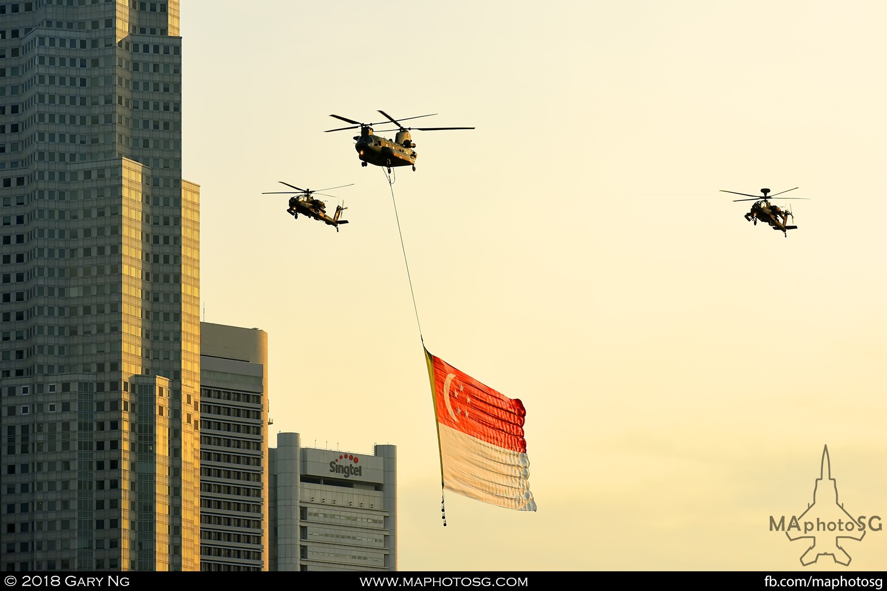 1850 – A CH47D Chinook escorted by two AH-64 Apaches performs the State Flag Fly Past