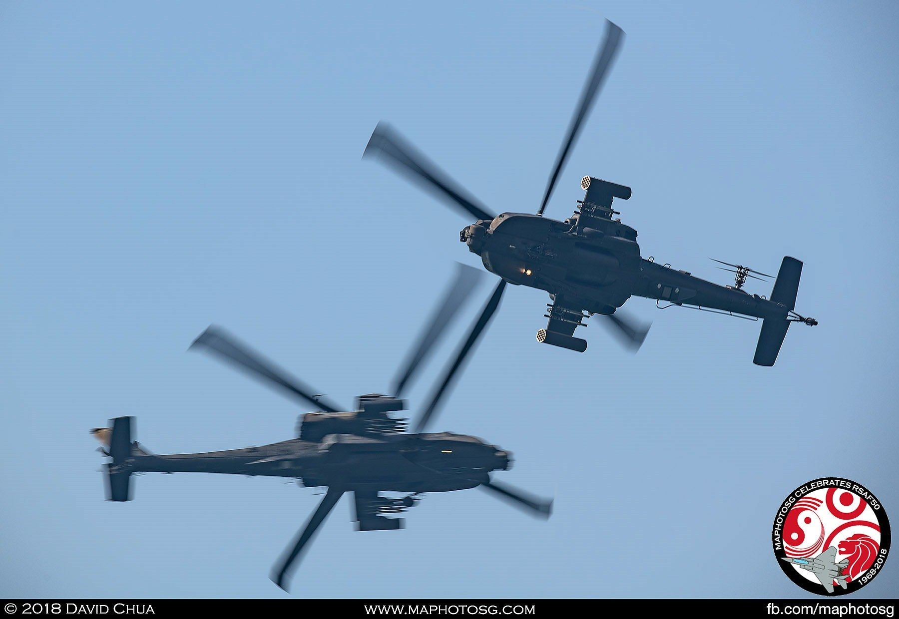 The two AH-64D helicopters break into each other and make a 90-degree turn as they approach the show centre to perform the Cross Dagger.