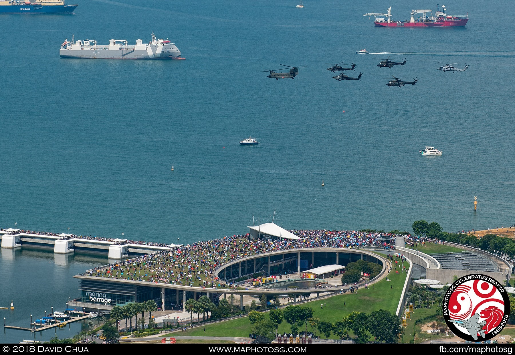 Helicopter formation flying over a packed Marina Barrage during the Saturday afternoon show.
