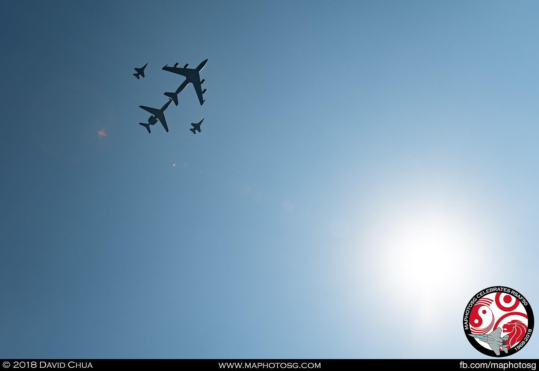 KC-135R Formation high above lighted by the afternoon sun