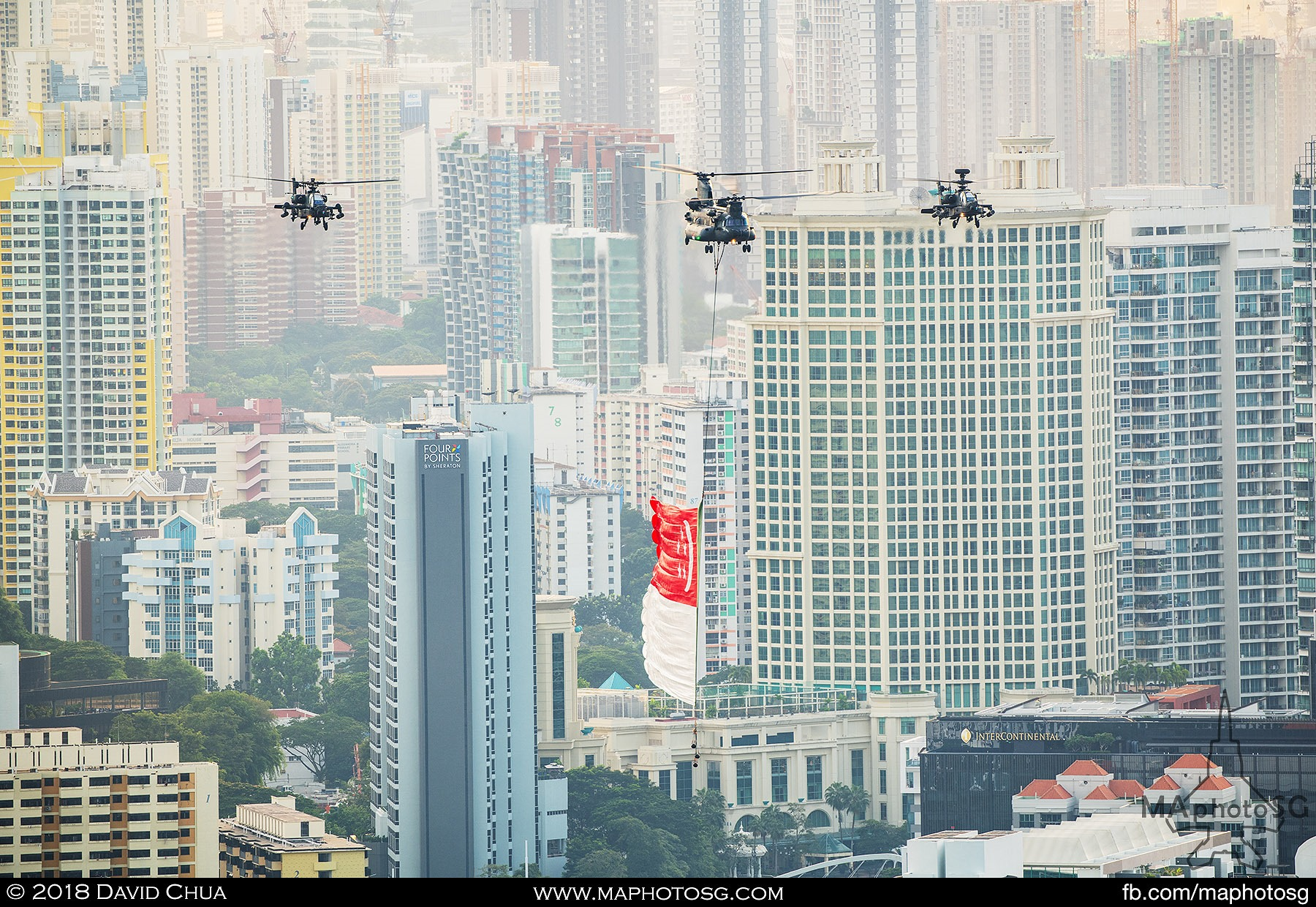 16. State flag fly past helicopters consisting of one RSAF CH-47D Chinook and two AH-6D Longbow Apaches enroute to the Floating Platform.