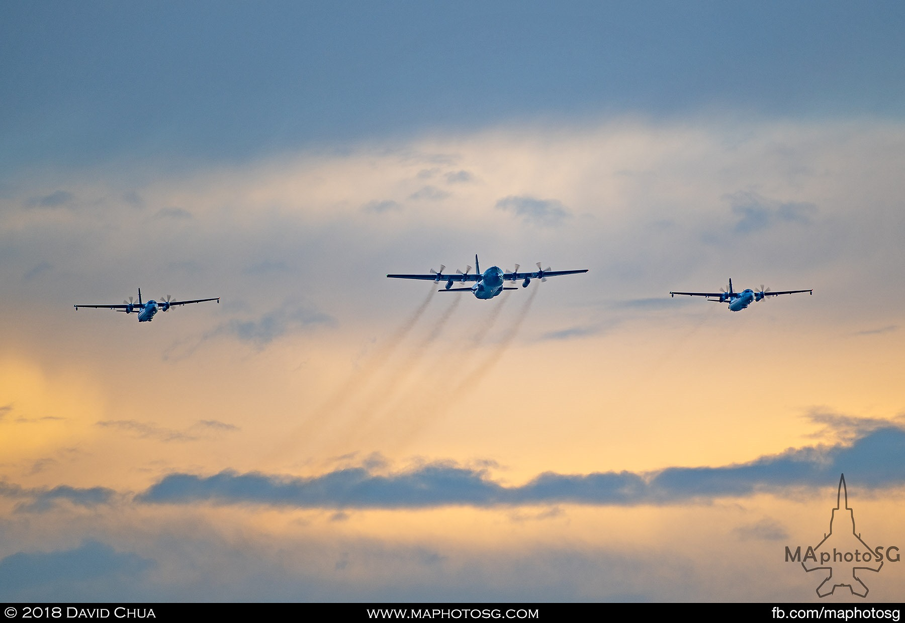 26. Transport formation of a C-130H Hercules flanked by two Fokker 50 Maritime Patrol Aircraft.
