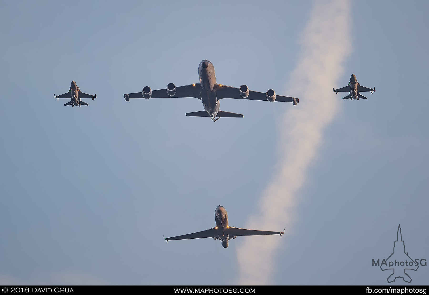 27. KC-135R Stratotanker escorted by to F-16C Vipers followed by a Gulfstream G550 CAEWS.