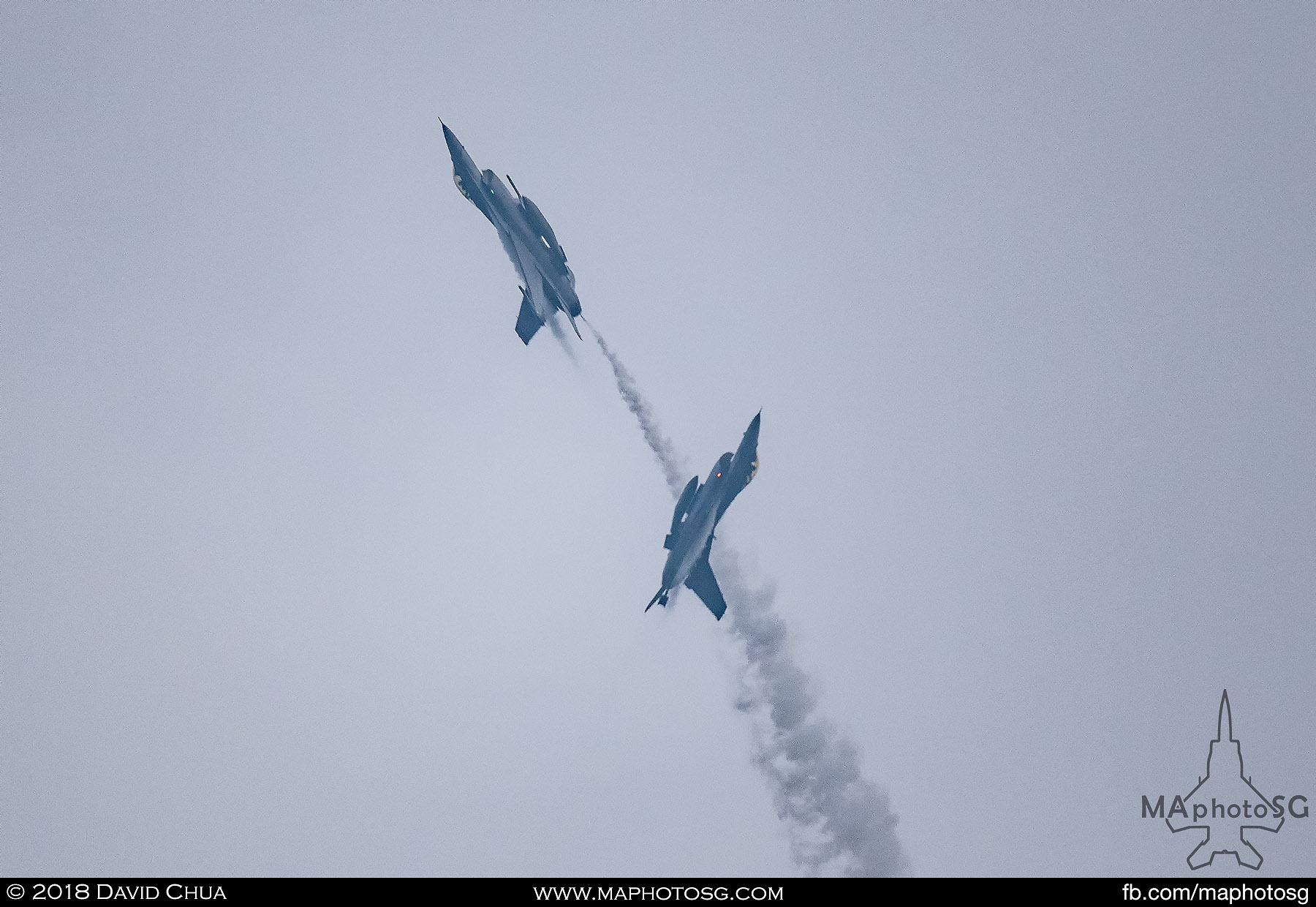 30. Two RSAF F-16C Vipers draws a heart in the sky with white smoke.