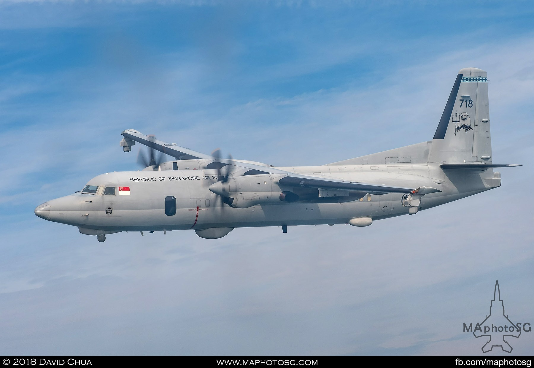 Fokker 50 MPA on the right side of the C-130H Hercules as it enters show center