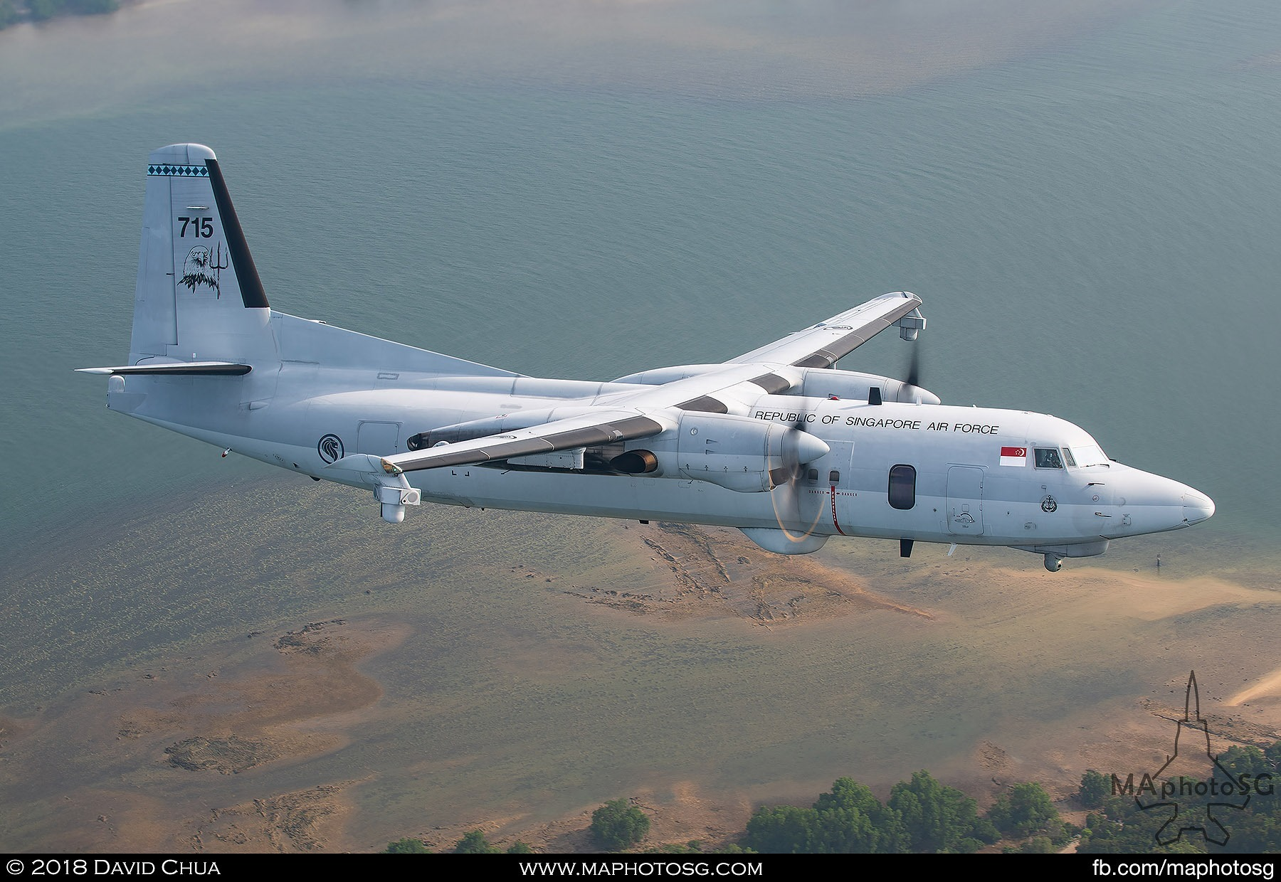 Fokker 50 MPA on the left side of the C-130H Hercules as it enters show center