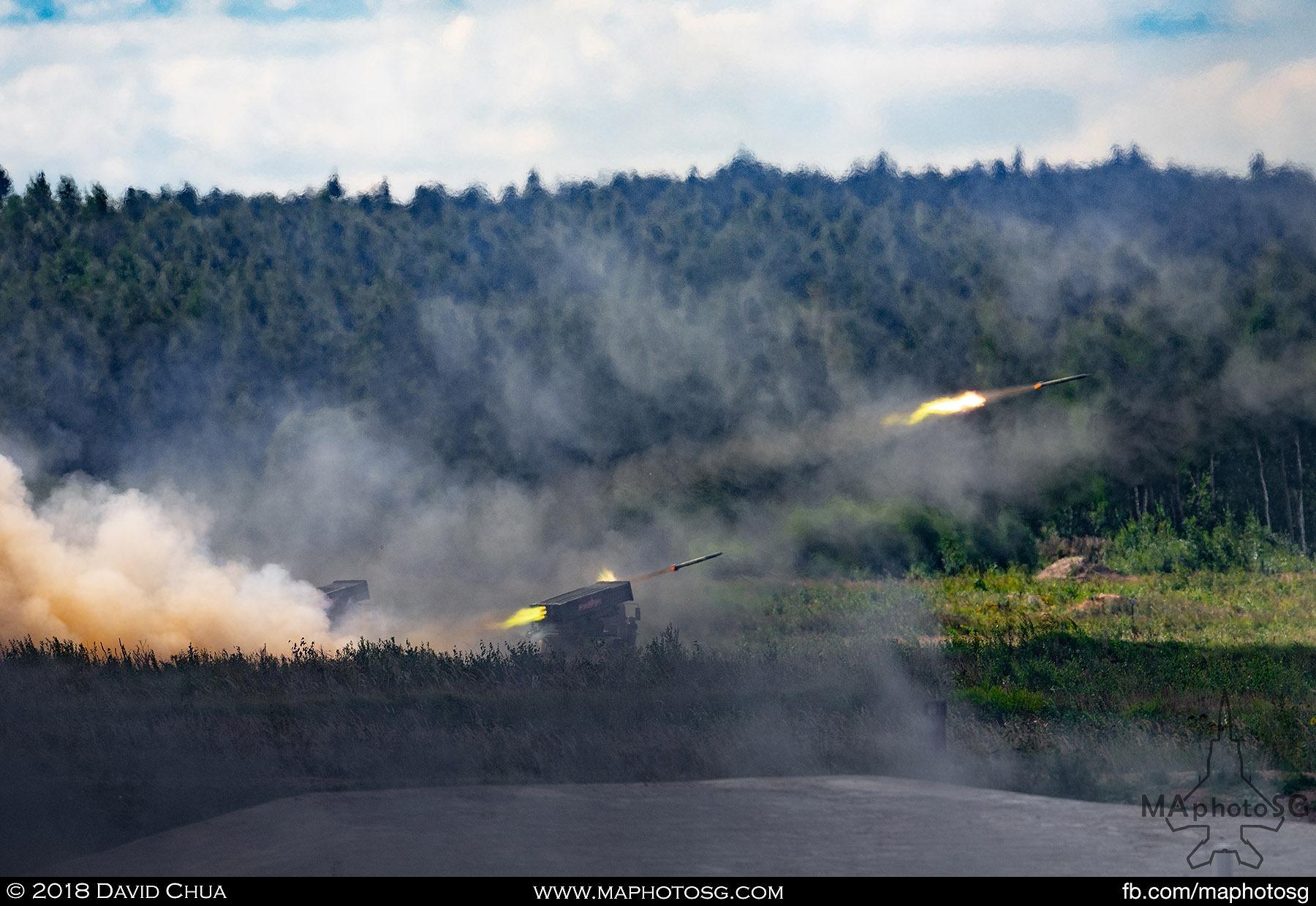 11. 9A52-4 'Tornado-G' 122/220 mm MLRS firing a salvo